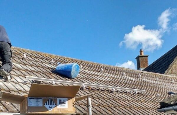 Roof with solar pv brackets fitted