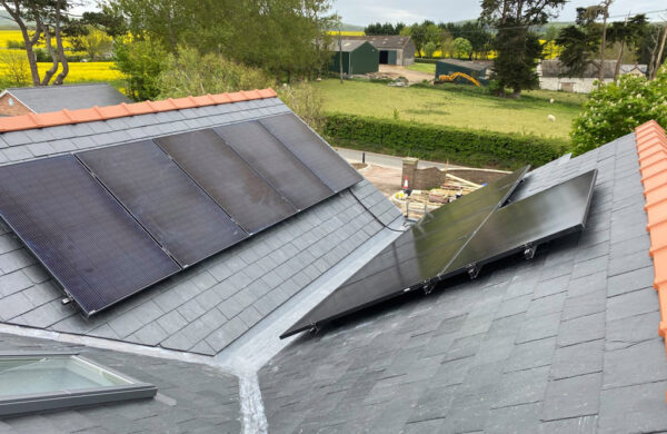 Solar panels fitted on a roof by island renewables