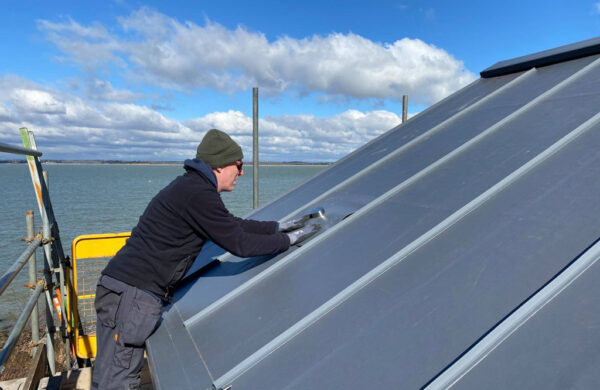 Solar panel brackets fitted to roof by island renewables