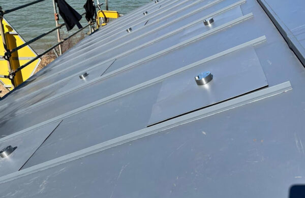 Solar panel brackets completed on a roof by island renewables