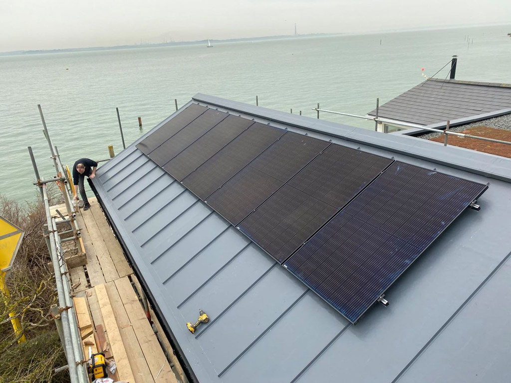 Solar panels secured to roof by island renewables gurnard isle of wight