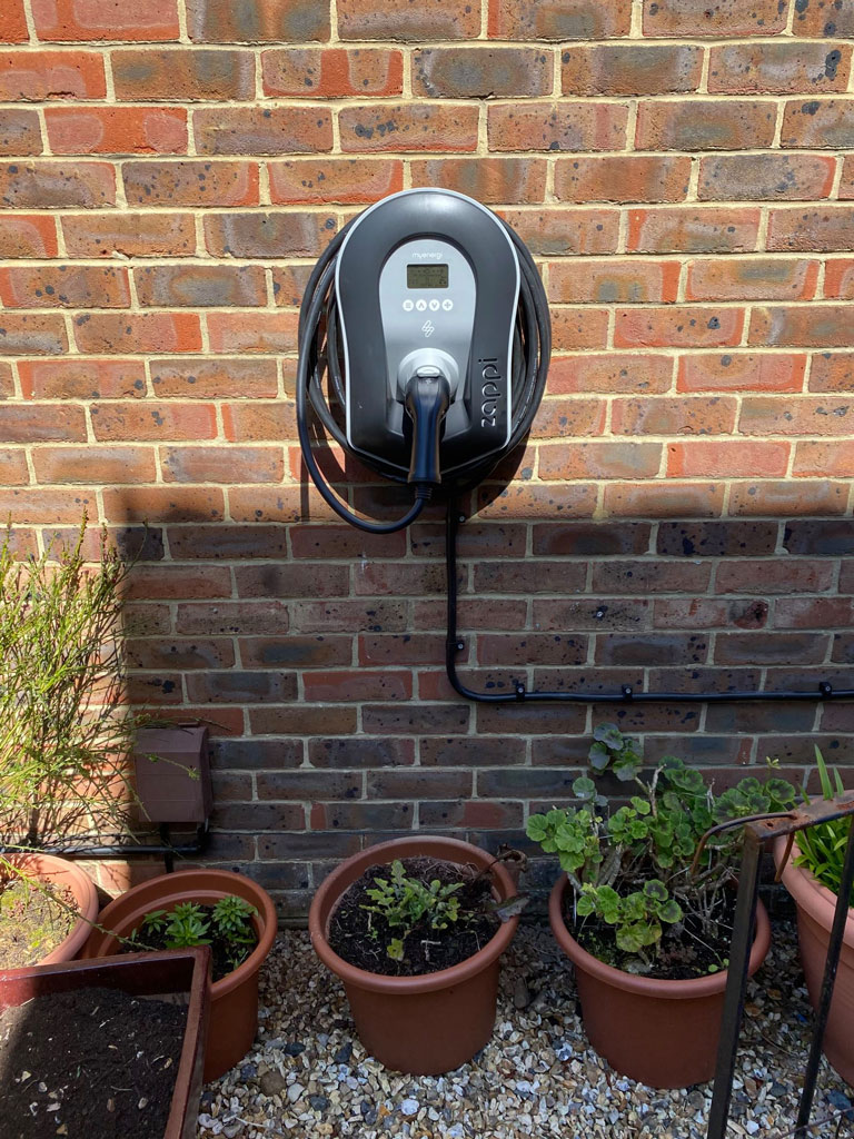 Zappi car charger fitted to wall island renewables