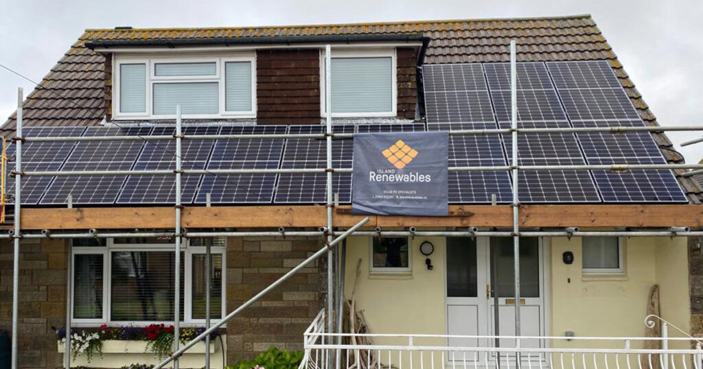 front view of house with solar panels on roof Island renewables